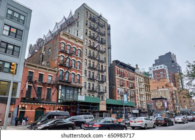 NEW YORK CITY - OCTOBER 02, 2016: Streetscape with bumper to bumper traffic on Bowery street with old worn apartment buildings