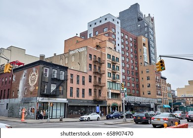 NEW YORK CITY - OCTOBER 02, 2016: Apartment building from various periodes on Bowery Street with traffic