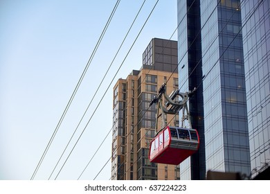 NEW YORK CITY - OCTOBER 05, 2016: The Roosevelt Island gondola hover by the skyscrapers on 60th street, high up in the air