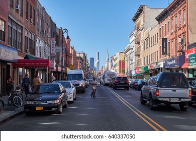 NEW YORK CITY - OCTOBER 05, 2016: The shopping street Manhattan Street, with low houses, in Greenpoint, Brooklyn