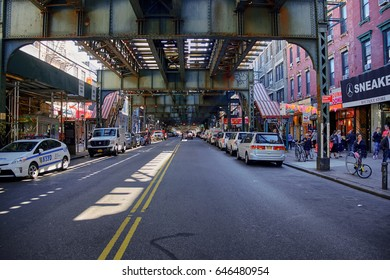 NEW YORK CITY - OCTOBER 05, 2016: Street view under the elevated train bridge at Marcy Avenue Metro station