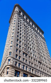 NEW YORK CITY - OCTOBER 06, 2015: Flatiron Building in Manhattan. Its a steel framed historical skyscraper, designated as NYC landmark and National Historic Landmark and registered in Historic Places