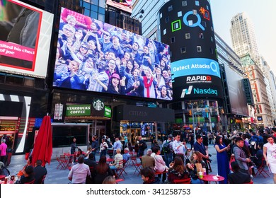 NEW YORK CITY - OCTOBER 06, 2015: Times Square with unidentified people. It is one of the worlds busiest pedestrian intersections and a major center of worlds entertainment industry