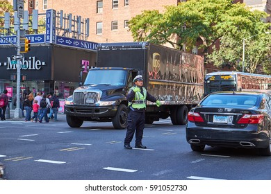 NEW YORK CITY - OCTOBER 06, 2016: A NYPD traffic officer conducting the traffic on 9th Avenue in Chelsea area