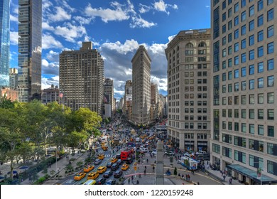 New York City - October 10, 2018: Aerial view of the Flat Iron building, one of the first skyscrapers ever built, with NYC Fifth Avenue and taxi cabs.