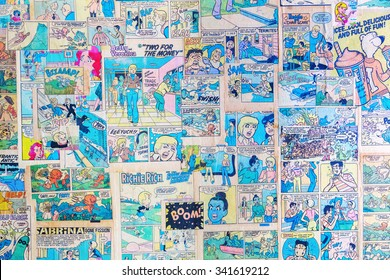 NEW YORK CITY - OCTOBER 10, 2015: antique comics used as wallpaper in a restaurant. Comics had a lowbrow reputation for much of history,  at end of the 20th century began they find greater acceptance