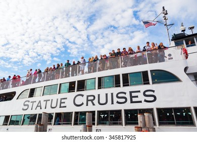 NEW YORK CITY - OCTOBER 13, 2015: passenger ferry to the Liberty Statue in NYC, with unidentified people. The Liberty Statue is located on Liberty Island and is one of the main landmarks of NYC