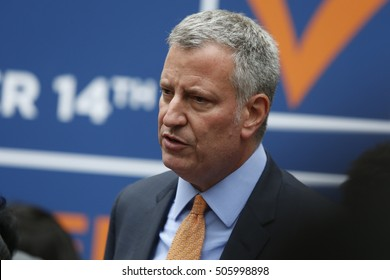 NEW YORK CITY - OCTOBER 13 2016: NYC mayor Bill de Blasio helped residents register to vote on Jay St after which he held a press conference calling for reform of NY's election's process