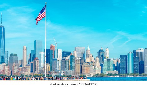 NEW YORK CITY - OCTOBER 21, 2015: Tourists in Ellis Island with city skyline. The city attracts 50 million people every year.