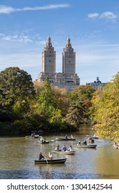 NEW YORK CITY - OCTOBER 22:  The public enjoy rowing their boats on the Lake in Central Park, New York City on October 22, 2017.  In the background are the San Remo Apartments.