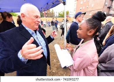 NEW YORK CITY - OCTOBER 23 2017: Brooklyn Public Library president Diane Johnson joined officials in groundbreaking for the Greenpoint Public Library. Richard Mazur interviewed by student journalist