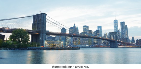 NEW YORK CITY - OCTOBER 25, 2015: Downtown Manhattan from Brooklyn Bridge Park. The city attracts 50 million people every year.