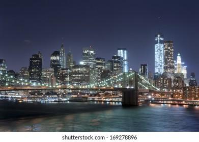 NEW YORK CITY - OCTOBER 27: Night scene of the Brooklyn bridge and Manhattan skyline, New York City on October 27th, 2013 in New York City, USA