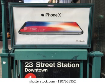 NEW YORK CITY - October 29, 2017: Apple Iphone X Advertisement. Smartphone developed marketed by Apple Inc. adopting OLED screen technology, wireless charging and Face IDnew authentication method