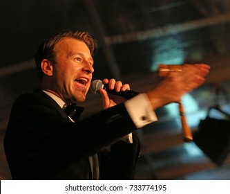 NEW YORK CITY - OCTOBER 5 2017: The Brooklyn Bridge Park Conservancy staged its 5th annual Black Tie Ball on the Park's Pier Two. Auctioneer Eric Hunt solicits bids