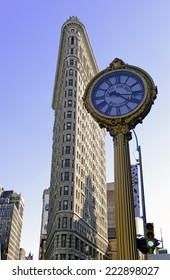 New York City - October 6, 2014.  The iconic 5th Avenue Clock with landmark Flatiron Building - a NYC landmark over 100yrs old, which in 1902 was one of the tallest skyscrapers in Manhattan.