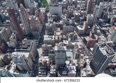 NEW YORK CITY - OCTOBER 9, 2014: Looking down on the buildings and streets south of Empire State Building