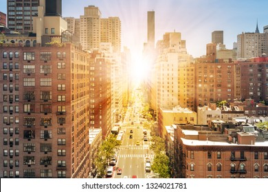 New York City overhead street view with sunlight shining on the streets and sidewalks of Midtown Manhattan