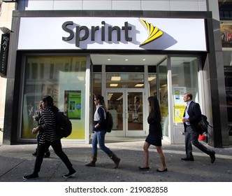 NEW YORK CITY - SEPT. 10, 2014: Pedestrians walk past a Sprint store in New York City, on September 10, 2014. Sprint Corporation is a telecommunications company that provides wireless services.