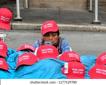 "New York City, September 11, 2018 - Woman selling ""Make America Great Again"" hats in Lower Manhattan."