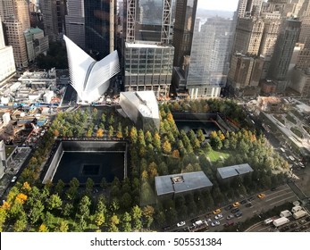 New York City - September 11 2016: Aerial view over the September 11th memorial in downtown Manhattan. Overlooking the fountains and Oculus transit mall. 9/11 9-11 Sept 9/11/01