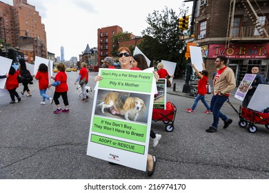 NEW YORK CITY - SEPTEMBER 13 2014: People Against Commercial Kennels, PACK, marched through the West Village to rally in Washington Square against puppy mills & pet stores that sell the offspring.