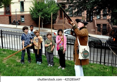 New York City - September 16, 2011:  Costumed docent demonstrates how to fire a musket to a group of kids at 1802 Hamilton Grange