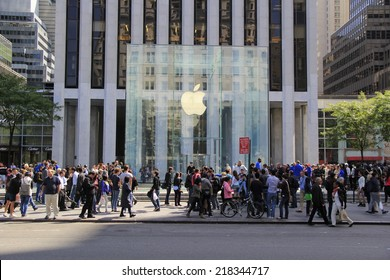 NEW YORK CITY - SEPTEMBER 19: Thousands of customers wait in line outside of the Apple Store on Fifth Avenue to be among the first to purchase the new iPhone 6 on September 19, 2014.