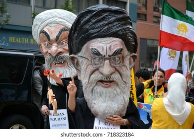 New York City - September 19, 2017: People protesting Iranian President Hassan Rouhani and Ali Hosseini Khamenei during the United Nations General Assembly in Midtown Manhattan.