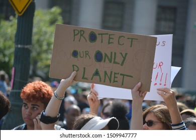 New York City, September 20, 2019: People taking part in the Global Climate Strike demanding action on climate change in Lower Manhattan.