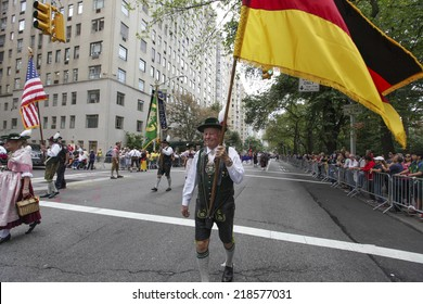 NEW YORK CITY - SEPTEMBER 20 2014: the 57th annual Steuben Parade is a celebration of German-American heritage held prior to the Central Park Oktoberfest. Marcher in lederhosen & German flag.