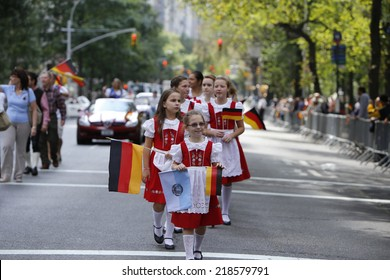 NEW YORK CITY - SEPTEMBER 20 2014: the 57th annual Steuben Parade on Fifth Avenue celebrates German-American heritage prior to Central Park's Oktoberfest. Little marchers in old country attire