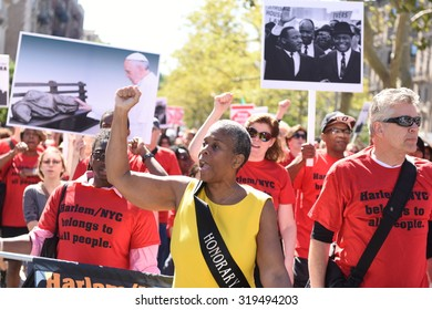 NEW YORK CITY - SEPTEMBER 20 2015: The 46th annual African-American Day Parade filled Adam Clayton Powell, Jr Blvd from 111th to 136th Sts. Dr Leonora Fulani marches with anti-gentrification activists