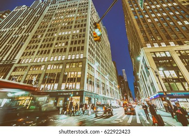 NEW YORK CITY - SEPTEMBER 2015: Traffic in the city at night. New York attracts 50 million people annually.