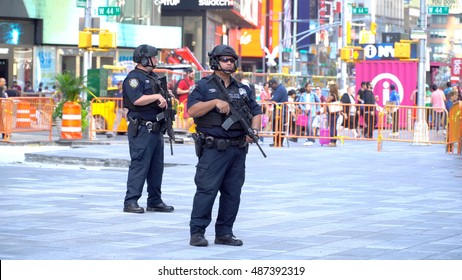 New York City - September 2016: NYPD Swat team officers armed with assault rifles patrol Times Square, heart of Manhattan and New York tourism. Target for terrorist attacks with suspicious package