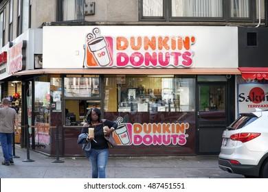New York City - September 2016: Dunkin Donuts coffee shop on the corner of a Manhattan street