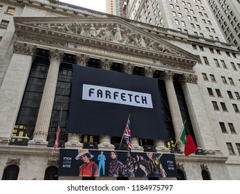 New York City - September 21, 2018: Banner on the New York Stock Exchange building celebrating the IPO of the on line fashion house Farfetch in Lower Manhattan.