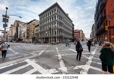 NEW YORK CITY - SEPTEMBER 22: Unidentified people walk and bike in Soho on September 22, 2011 in Manhattan, New York, NY