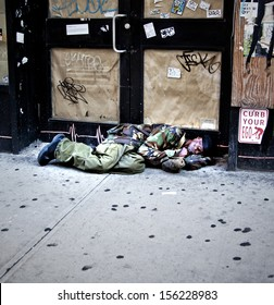 New York City - SEPTEMBER 22: Homeless man asleep on the street on September 22, 2013  in Manhattan, New York. Homelessness effects over 55K people, 21K which are children, each night in NYC.