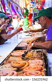 NEW YORK CITY - SEPTEMBER 22: Vendors cooking and serving food at the San Gennaro festival in New York City on September 22, 2013.