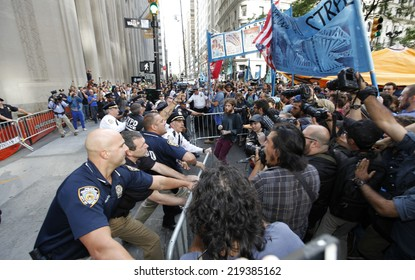 NEW YORK CITY - SEPTEMBER 22 2014: Flood Wall Street demonstrators marched from Battery Park, for a sit down at Broadway & Morris St, before preceding up to Wall Street itself where NYPD made arrests.