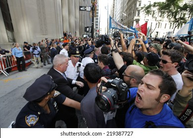 NEW YORK CITY - SEPTEMBER 22 2014: Flood Wall Street demonstrators marched from Battery Park to Broadway & Morris St for a sit down before proceeding to Wall St where NYPD made numerous arrests