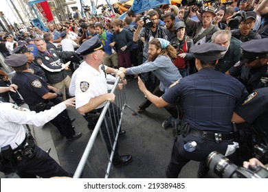 NEW YORK CITY - SEPTEMBER 22 2014: Flood Wall Street demonstrators marched from Battery Park to Broadway & Morris St where they staged a sit in before moving on to Wall St where NYPD made many arrests