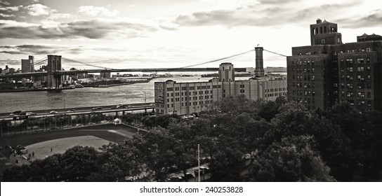 NEW YORK CITY - SEPTEMBER 22: View of the Booklyn bridge, river, baseball field and buildings from the Manhattan bridge in black and white. Taken on September 22, 2013 in New York City, NY.