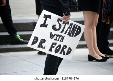 New York City - September 24, 2018: People at a rally supporting Dr. Blasey Ford and victims of sexual assault at City Hall in Lower Manhattan.