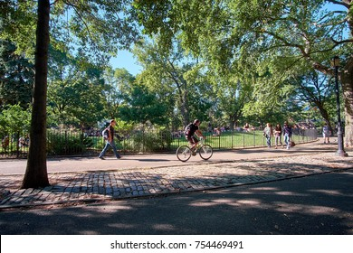 NEW YORK CITY - SEPTEMBER 24, 2016: People walking and cycling in Tompkins Square Park in East Village on a warm October day