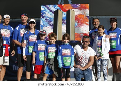 NEW YORK CITY - SEPTEMBER 25 2016: the 15th annual Stephen Sillers Tunnel to Towers 5K Run/Walk saw record number of participants. Patriot artist Scott LoBaido with participant families