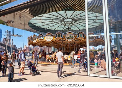 NEW YORK CITY - SEPTEMBER 25, 2016: People standing looking at Jane's carousel in Brooklyn Bridge Park