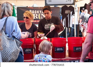 NEW YORK CITY - SEPTEMBER 25, 2016: Handing out pickles to visitors at Pickle Day in Orchard St on Lower East Side