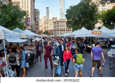 NEW YORK CITY - SEPTEMBER 26, 2016: People walking in a crowd at the food market on Union Square on Manhattan